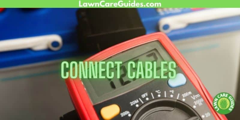 connect cables on a multimeter for a lawn mower