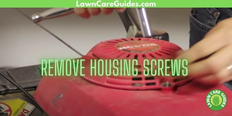 how to remove the housing screws on a on the pull cable lawnmower